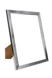 Алюминиевая пустая рамка фото на белой предпосылке Стоковое Изображение RF