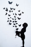Бабочки покрашенные на стене Стоковое Изображение