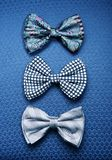 3 бабочки против голубой предпосылки ткани Стоковое Изображение RF
