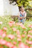 Бабушка в саде Стоковое фото RF