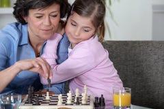 Бабушка играя шахмат стоковые изображения