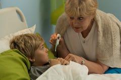 Бабушка принимая температуру Стоковая Фотография RF