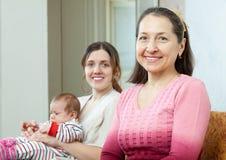 Бабушка с молодыми матерью и младенцем Стоковая Фотография