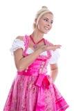 Баварская женщина - изолированная в баварские представлять и makin платья стоковое фото