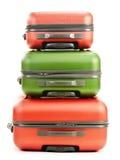 Багаж состоя из 3 чемоданов на белизне стоковое изображение