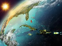 Багамские острова на земле планеты в заходе солнца Стоковое фото RF
