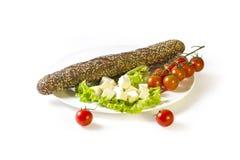 Багет, сыр, томаты, салат выходит Стоковое Фото