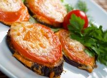 баклажан зажарил в духовке томат Стоковые Изображения