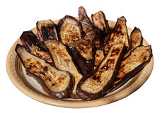 Баклажаны зажарили и клали на керамическую плиту Изолированный на whi Стоковые Фото