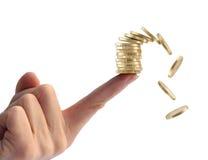 Балансируя монетки финансов рушясь Стоковые Изображения