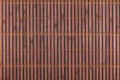 Бамбуковая коричневая циновка как абстрактная текстура, предпосылка, состав Стоковая Фотография