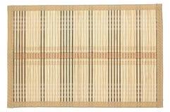 Бамбуковая циновка - смогите быть использовано как предпосылка Изолировано на белизне Стоковое Изображение