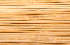 Бамбуковые ручки штабелированные рядом друг с другом Стоковая Фотография