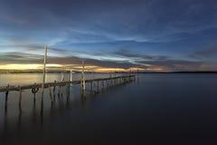 Бамбуковый мост в море сумерк Стоковые Изображения