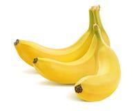3 банана в пуке на белизне Стоковое Фото