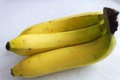 3 банана на белой предпосылке Стоковое фото RF
