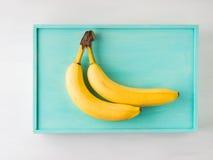 2 банана на зеленой пастели Стоковая Фотография RF