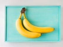2 банана на зеленой пастели Стоковое фото RF
