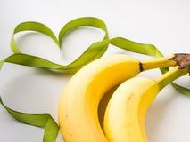 2 банана с зеленой рамкой ленты Стоковое Изображение