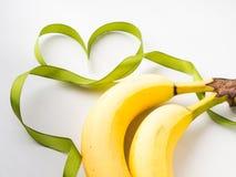 2 банана с зеленой рамкой ленты Стоковые Изображения