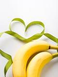 2 банана с зеленой рамкой ленты Стоковое фото RF