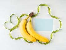 2 банана с зеленой рамкой ленты Стоковые Изображения RF