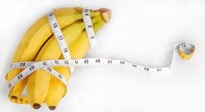 бананы измеряют ленту Стоковые Фотографии RF