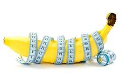 бананы измеряя ленту обернули Стоковая Фотография RF