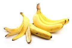 Бананы и кожа банана на белизне Стоковая Фотография