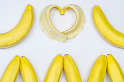 Бананы и сердце банана на белизне Стоковая Фотография RF
