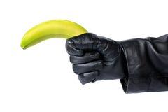 Банан вместо оружия стоковая фотография