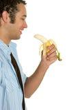 банан есть человека Стоковое Изображение