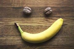 Банан и лимоны на деревянной предпосылке, здоровая еда, здоровье Стоковые Фото