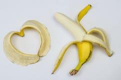 Банан и сердце банана на белизне Стоковые Изображения