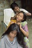 Бангладешский заказ подростка совместно их волосы стоковая фотография rf