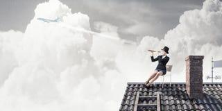 Банкир женщины на верхней части дома Мультимедиа Стоковая Фотография RF