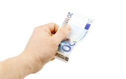 Банкнота в деноминации евро 20 в руке Стоковые Изображения