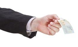 Банкнота евро 5 в руке бизнесмена Стоковые Изображения RF