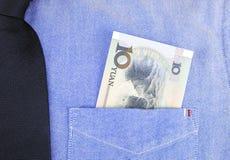Банкнота RMB в карманн рубашки Стоковое фото RF