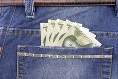 Банкнота RMB в карманн Стоковая Фотография