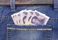 Банкнота RMB в карманн Стоковое Фото