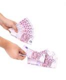 Банкноты владением рук евро. Стоковые Изображения