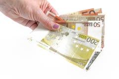 Банкноты в женской руке Стоковые Изображения RF