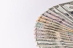 Банкноты денег США на белой предпосылке Стоковые Изображения