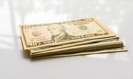 Банкноты доллара конца-вверх американские Стоковые Изображения RF