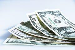 Банкноты доллара на белой предпосылке Стоковое Изображение