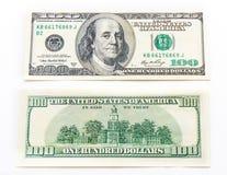 Банкноты долларов одного hundert на белой предпосылке Стоковая Фотография