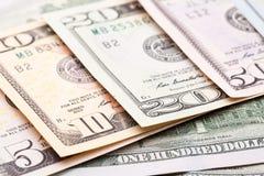 Банкноты долларов с различными деноминациями Стоковое Изображение