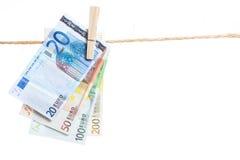 Банкноты евро вися от веревочки Стоковые Изображения RF