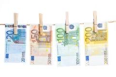 Банкноты евро вися от веревочки Стоковая Фотография RF